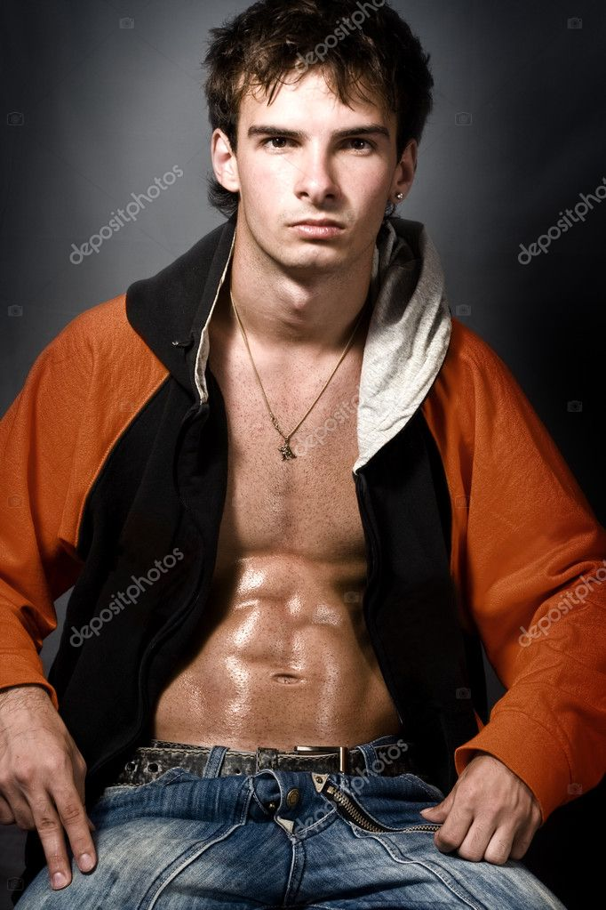 Portrait of atheltic young man showing his muscular abs — Stock Photo #4943233