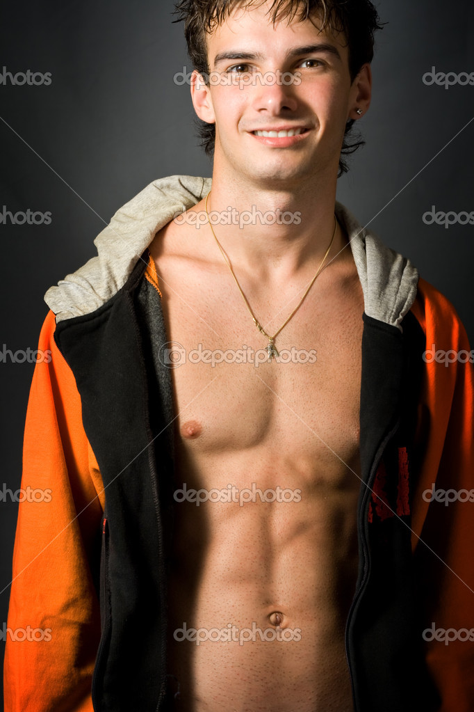 Portrait of young sexy man smiling with nice abs — Stock Photo #4943258