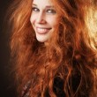 Redhead woman with beautiful long hair — Stockfoto