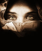 Sensual eyes of mysterious woman — Stock Photo