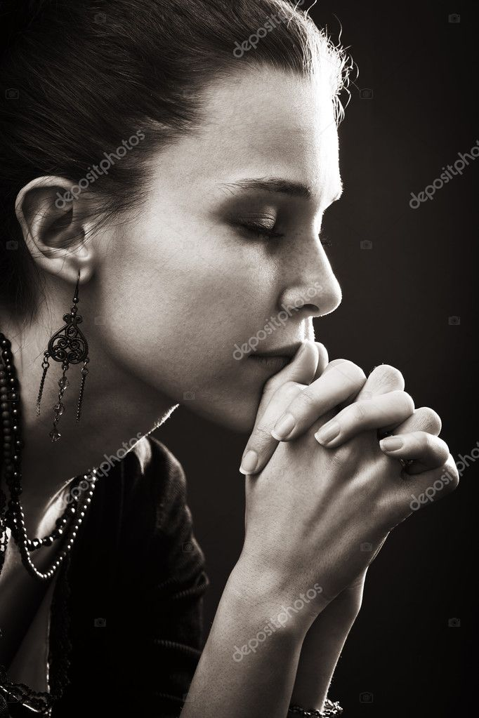 Faith and religion - spiritual woman praying in darkness — Stockfoto #5157830