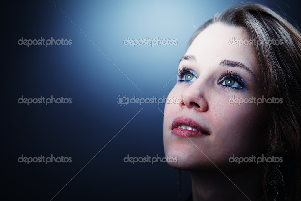 Hopeful young cute woman glancing into her future  Stock Photo #5228801