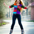Happy woman on roller skates - Stock Photo