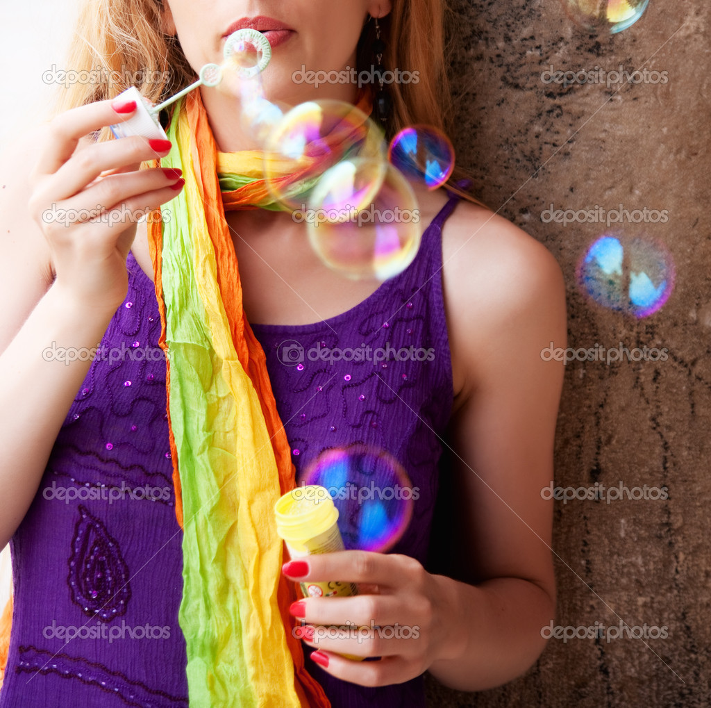 Woman blowing many colorful soap bubbles — Stock Photo #5331026