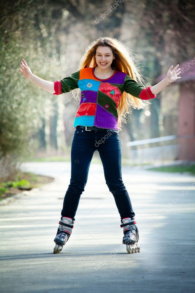 Happy young active woman on roller skates — Stock Photo #5331032