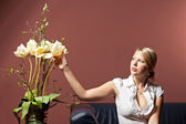 Sensual woman with flowers — Stock Photo