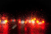 Blurred car lights in the rain — Stock Photo