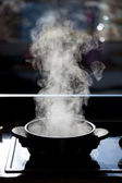 Steam rising off a boiling pot — Stock Photo
