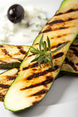 Grilled zucchini with a rosemary leaf — Stock Photo