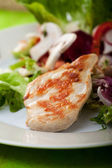 Piece of grilled chicken breast — Stock Photo