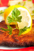 Closeup of a lemon slice on a wiener schnitzel — Stock Photo