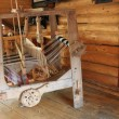 Antique spinning wheel - Stock Photo