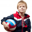 The cute little boy in a jumpsuit holds a ball — Stockfoto