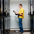 Stock Photo: Engineer stand in datacenter