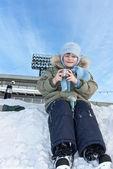 The child with skates on the stadium — Stock Photo