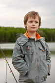 The little boy fishes. — Stock Photo