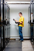 The engineer stand in datacenter — Stock Photo