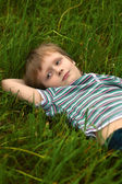 The little boyi in a grass — Стоковое фото