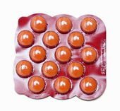 Pack of orange medicine pills — Stock Photo