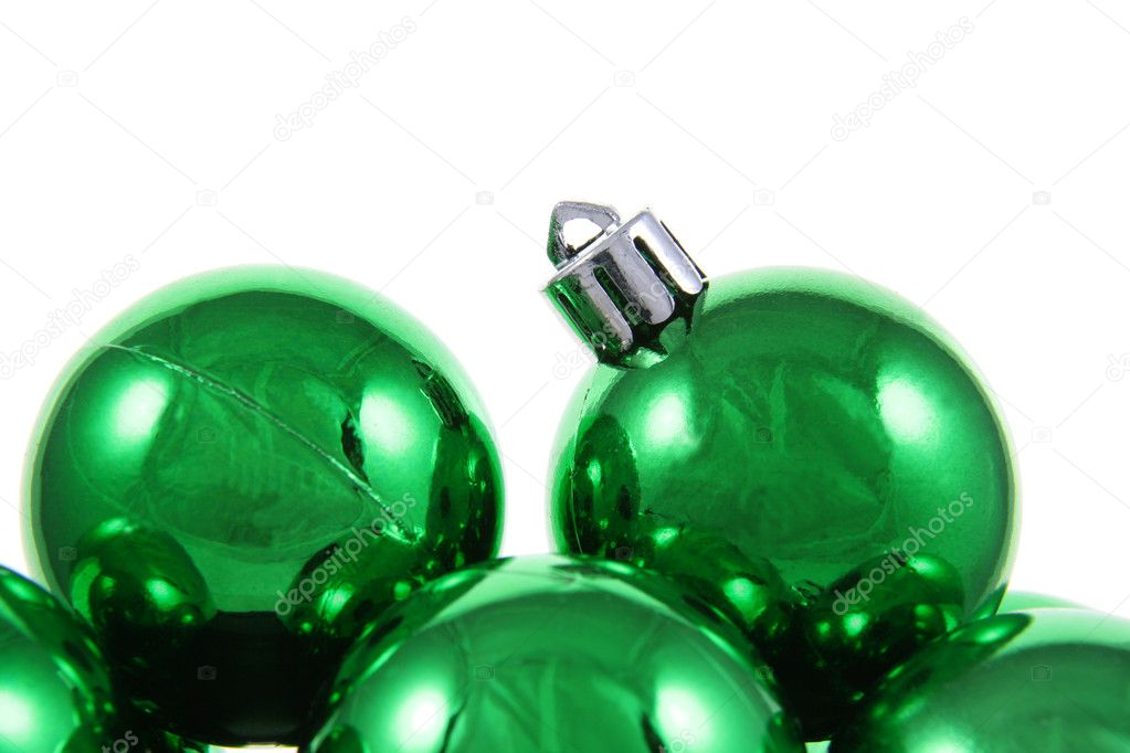 A bunch of green Christmas baubles against a white background. — Stock Photo #4047755