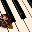 Bauble on Piano Keys — Stock Photo
