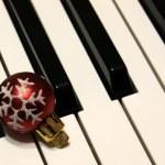 Bauble on Piano Keys — Stock Photo