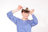 Middle aged female dressed as sailor in striped shirt and captain hat posin — Stock Photo