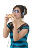 Woman with hamburger, sunglasses and head phones — Stock Photo
