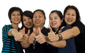 Asian women with thumbs up — Stock Photo