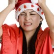 Disappointed woman with santa claus hat — Stock Photo