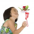 Cute girl with flower gift — Stock Photo