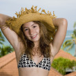 Teenager in front of a holiday resort - Stok fotoraf