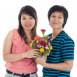 Two asian women with flowers — Stock Photo