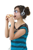 Woman with hamburger, sunglasses and head phones — Stock Photo