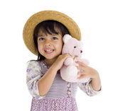 Cute little girl with pink teddy bear — Stock Photo