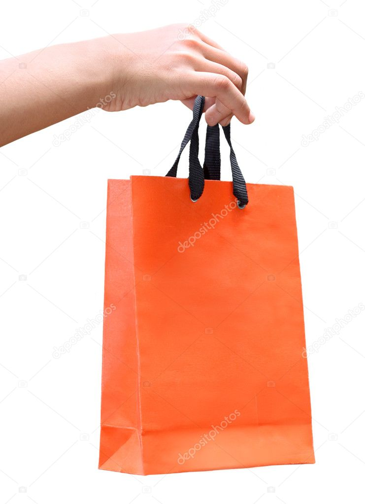 Hand holding a paper bag over white background  Stock Photo #3964827