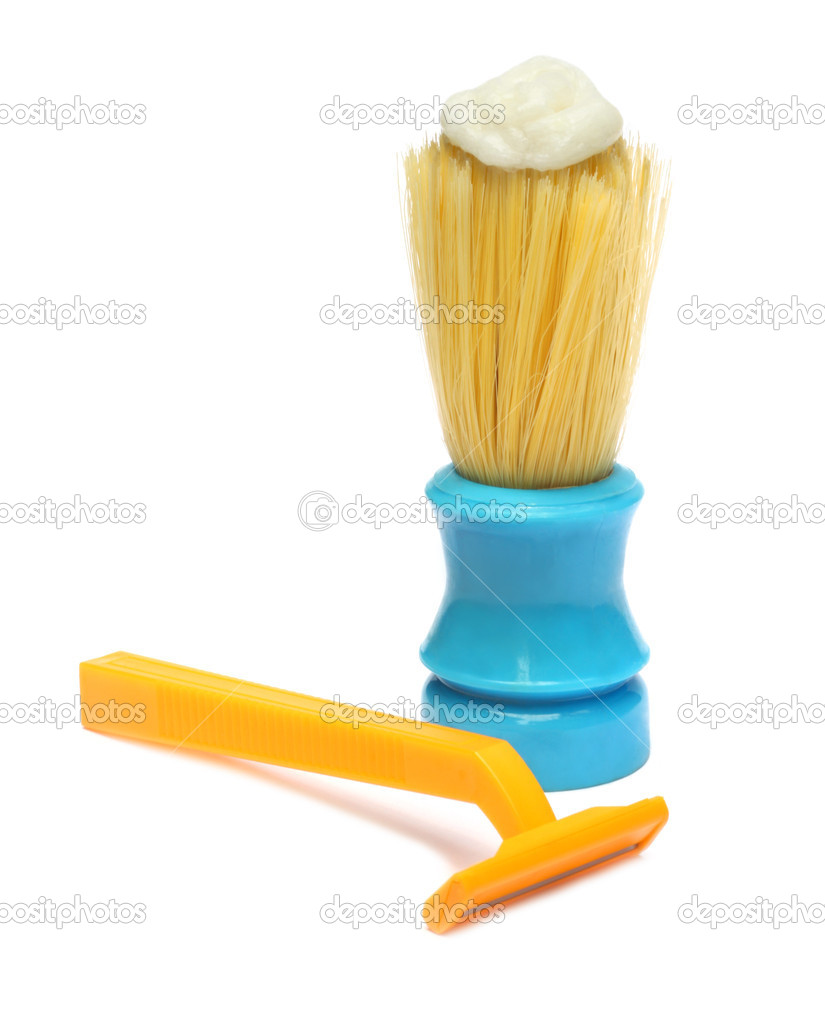 Razor and brush with shaving cream over white backgound — Stock Photo #3964851
