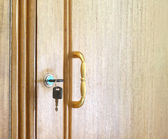 Wooden cupboard with keys — Stock Photo