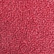 Texture of a maroon door mat - Foto Stock