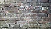 Old dirty wall of bricks — Stock Photo