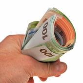 Rollo de billetes en euros en la mano. — Foto de Stock