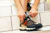 Boy tying his shoe — Stock Photo
