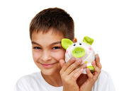 Teenage boy with piggy money box — Stock Photo