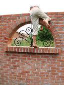 Escape over brick wall — Stock Photo