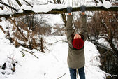 Teenage girl in snowy park — Stockfoto