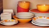 Plates on shelf — Stock Photo