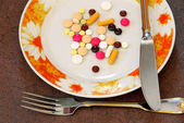Pills on plate — Stock Photo