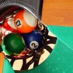Balls in Billiards table pocket — Stock Photo #5111988