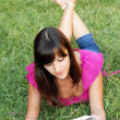 Stock Photo: Young woman reading a book