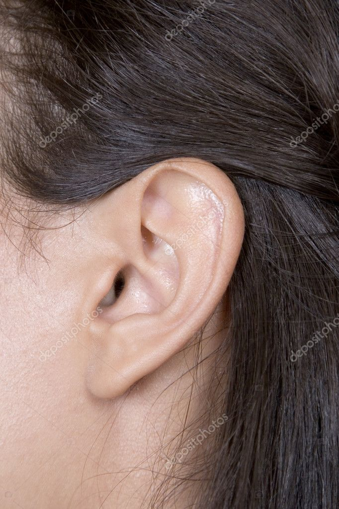 Closeup of young caucasian woman ear, brunette woman  — Stock Photo #4337269